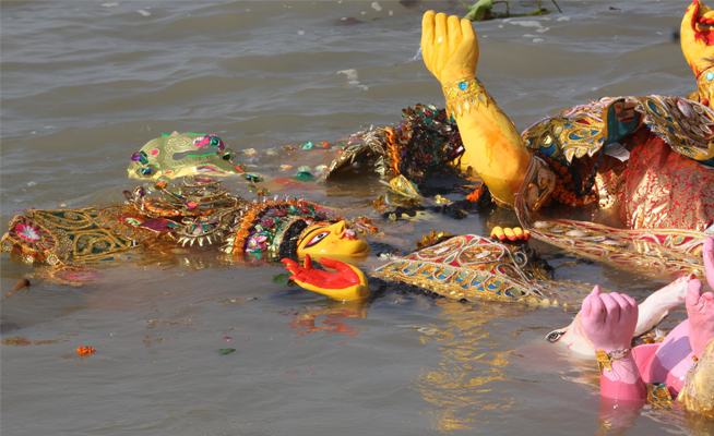 puja-idol-in-river
