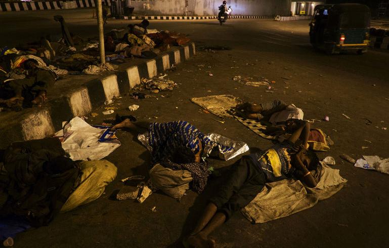 homeless people sleeping on the street