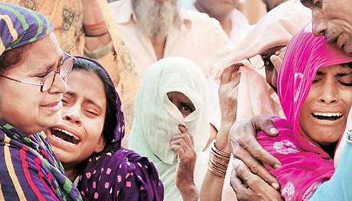 Family members and relatives mourn the death of farmer Mohammad Akhlaq