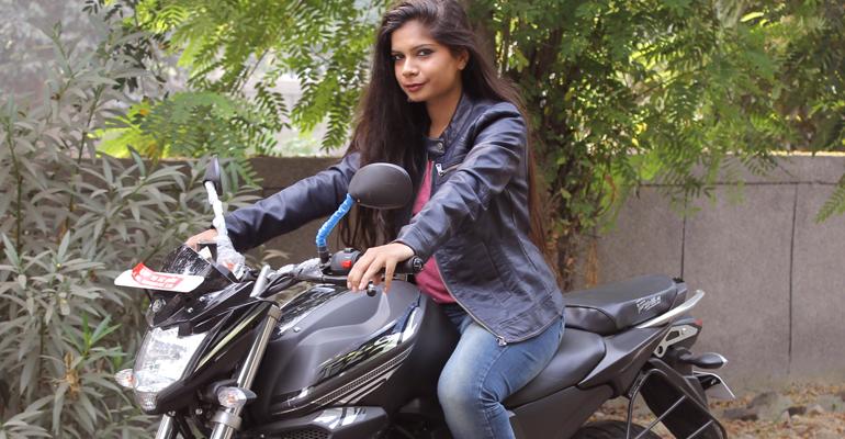 women ride bike